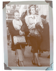 Women walking with shopping bags, circa 1940s
