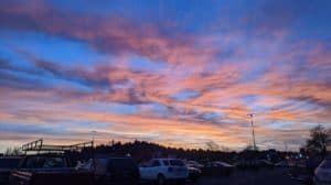 Pink and blue sunset over parking lot